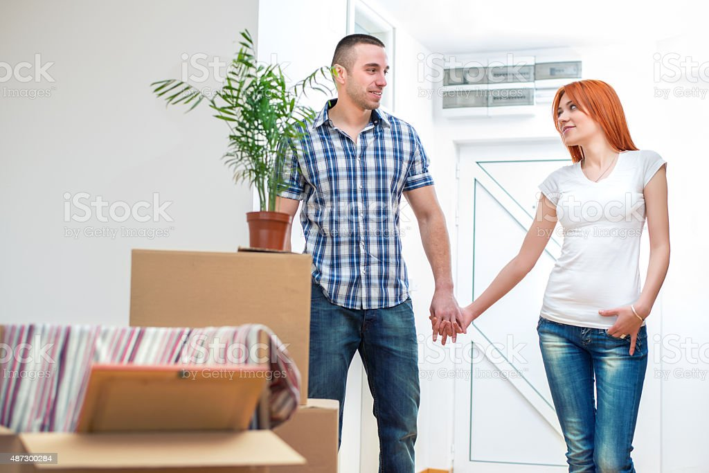Young couple in a new Apartment stock photo