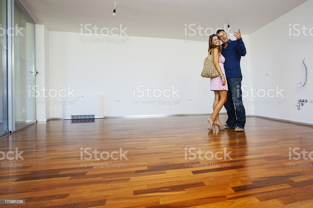 Young couple in a new flat royalty-free stock photo