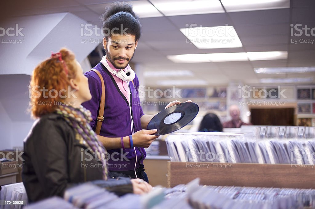 young couple in a record shop royalty-free stock photo