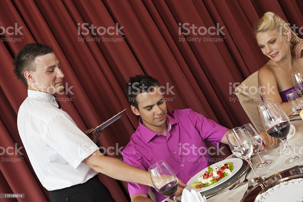 Young couple in a restaurant royalty-free stock photo