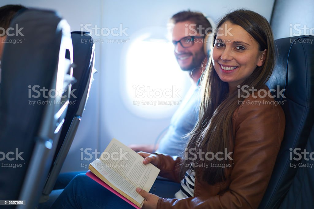 young couple in airplane stock photo