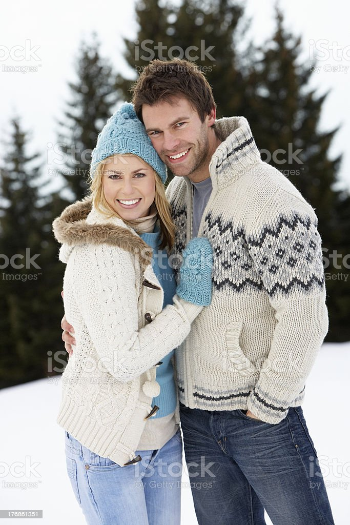 Young Couple In Alpine Snow Scene royalty-free stock photo