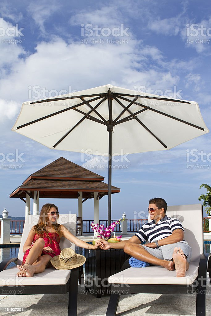 Young couple in armchairs stock photo