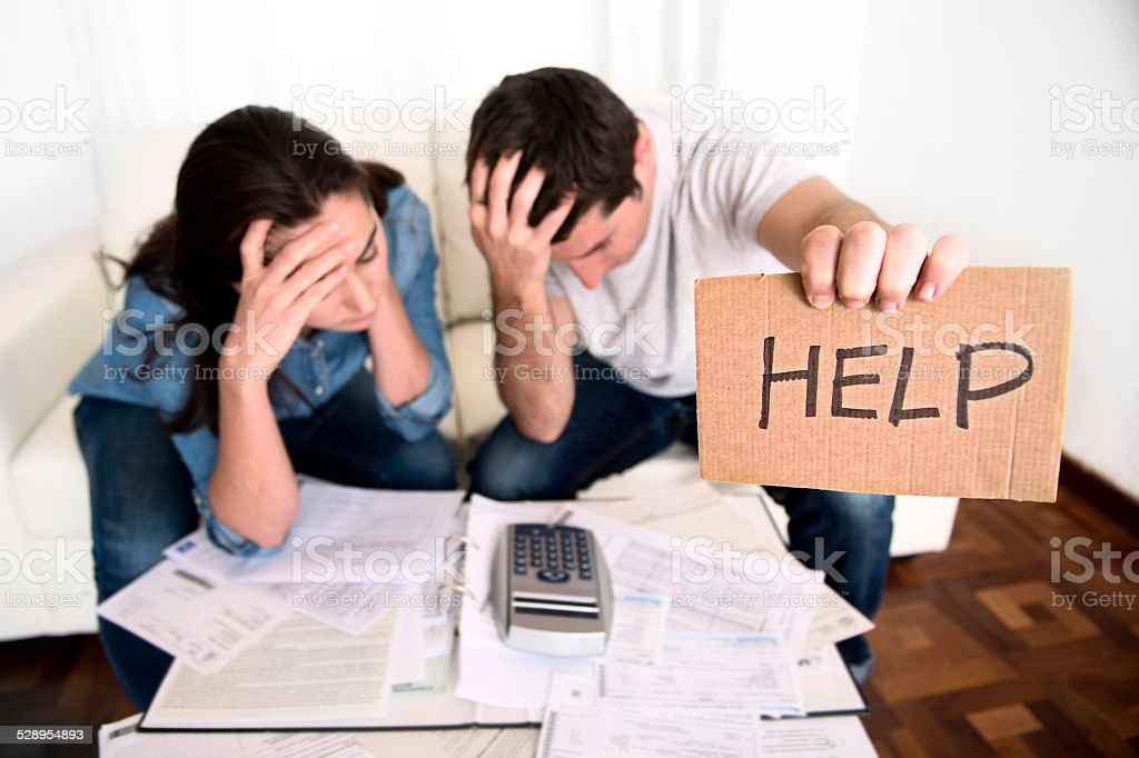 young couple in bad financial situation stress asking for help stock photo