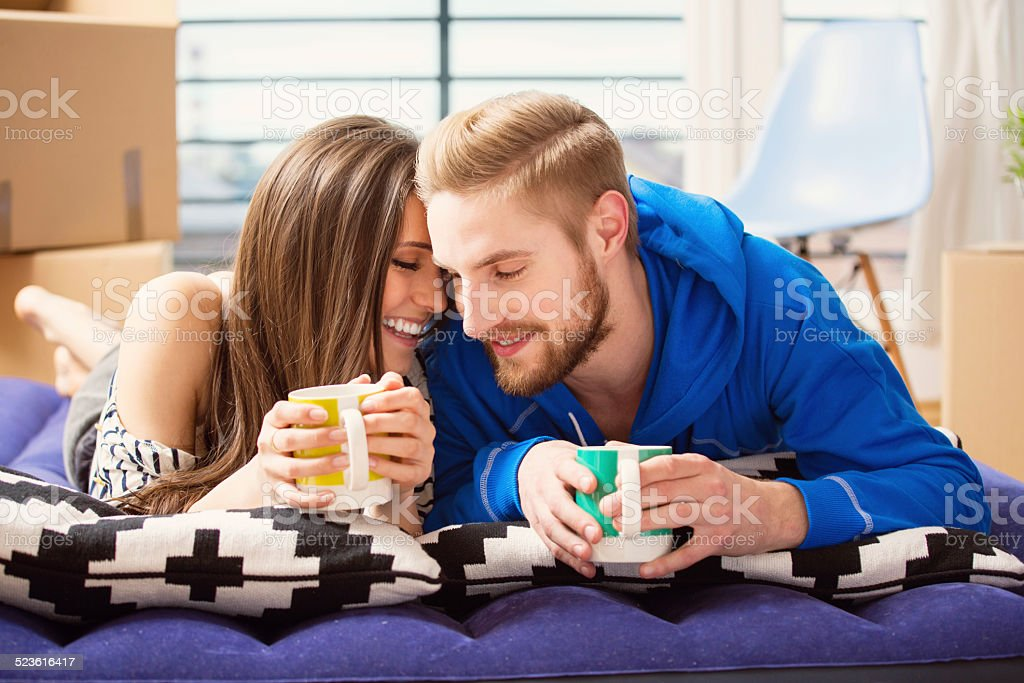 Young couple in bed at home stock photo