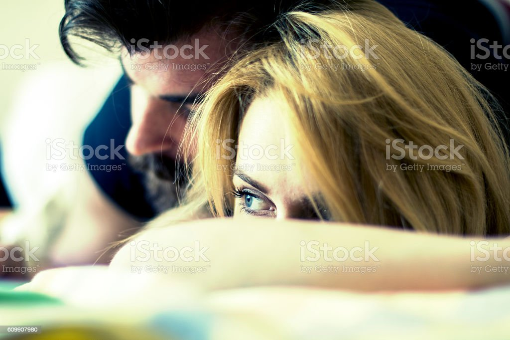 Young couple in bed, closeup stock photo