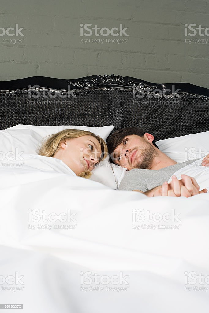 Young couple in bed royalty-free stock photo