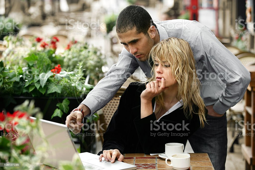 Young Couple in Cafe Working on Laptop royalty-free stock photo
