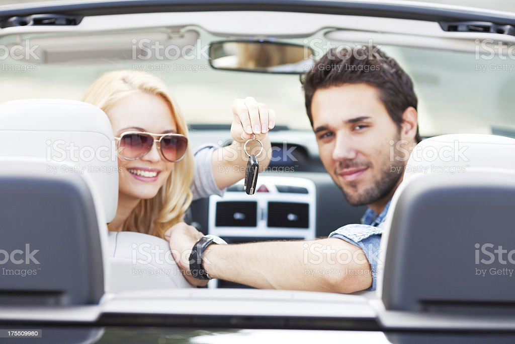 Young couple in car stock photo