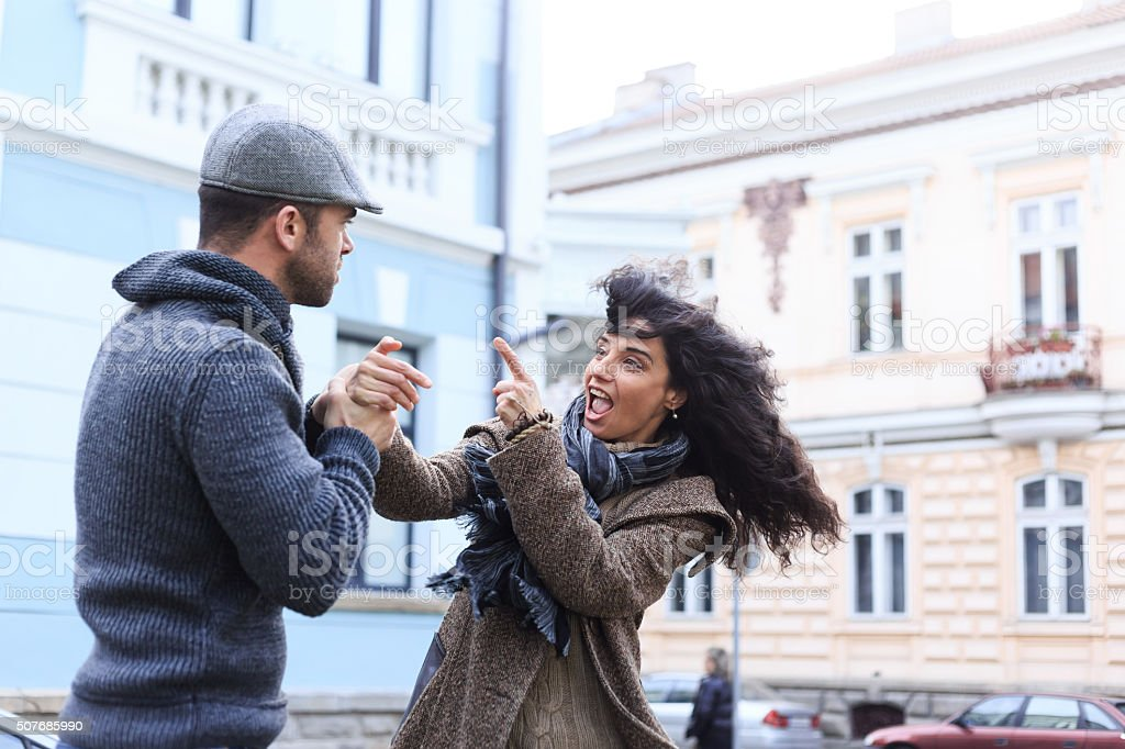 Young couple in conflict on street stock photo
