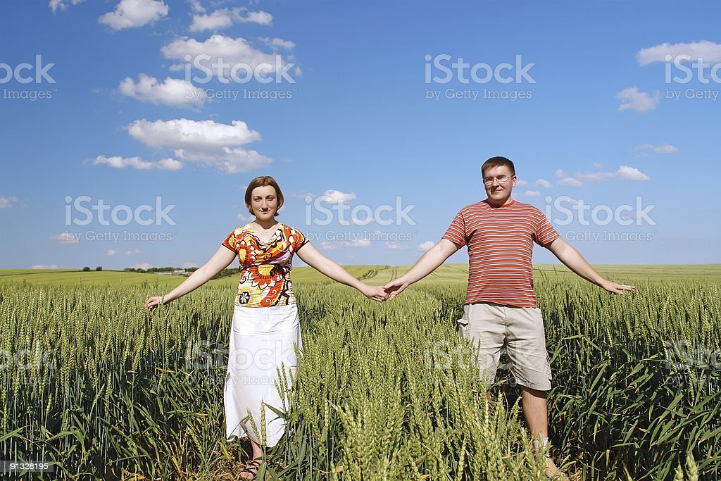 Young couple in cornfield royalty-free stock photo