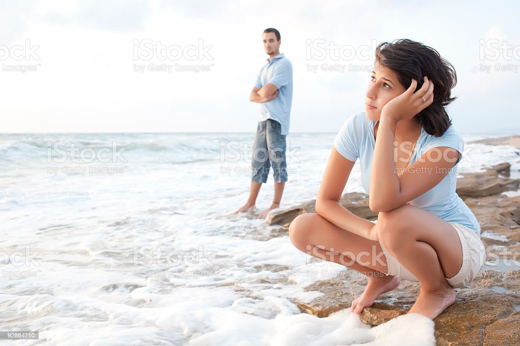 Young couple in crisis on the beach royalty-free stock photo