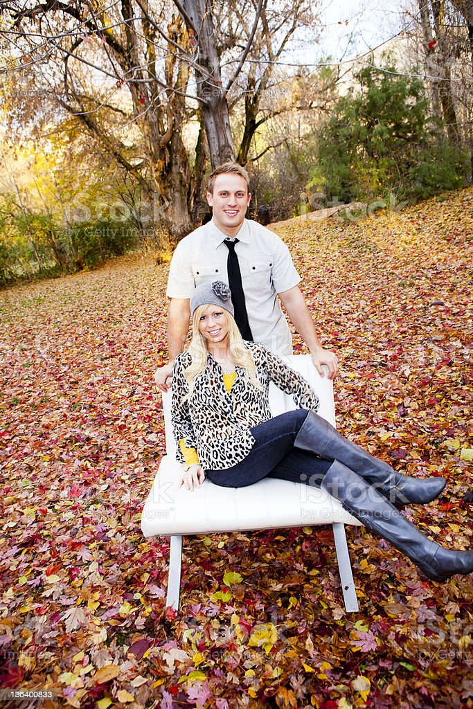 Young Couple in Fall Leaves stock photo
