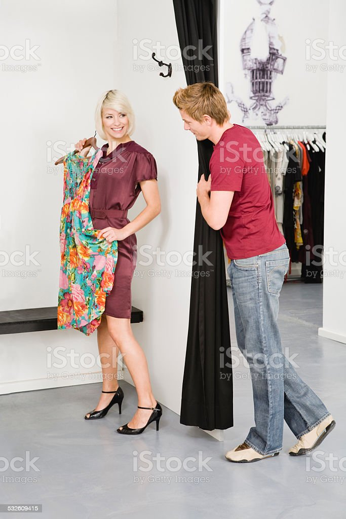 Young couple in fashion shop stock photo
