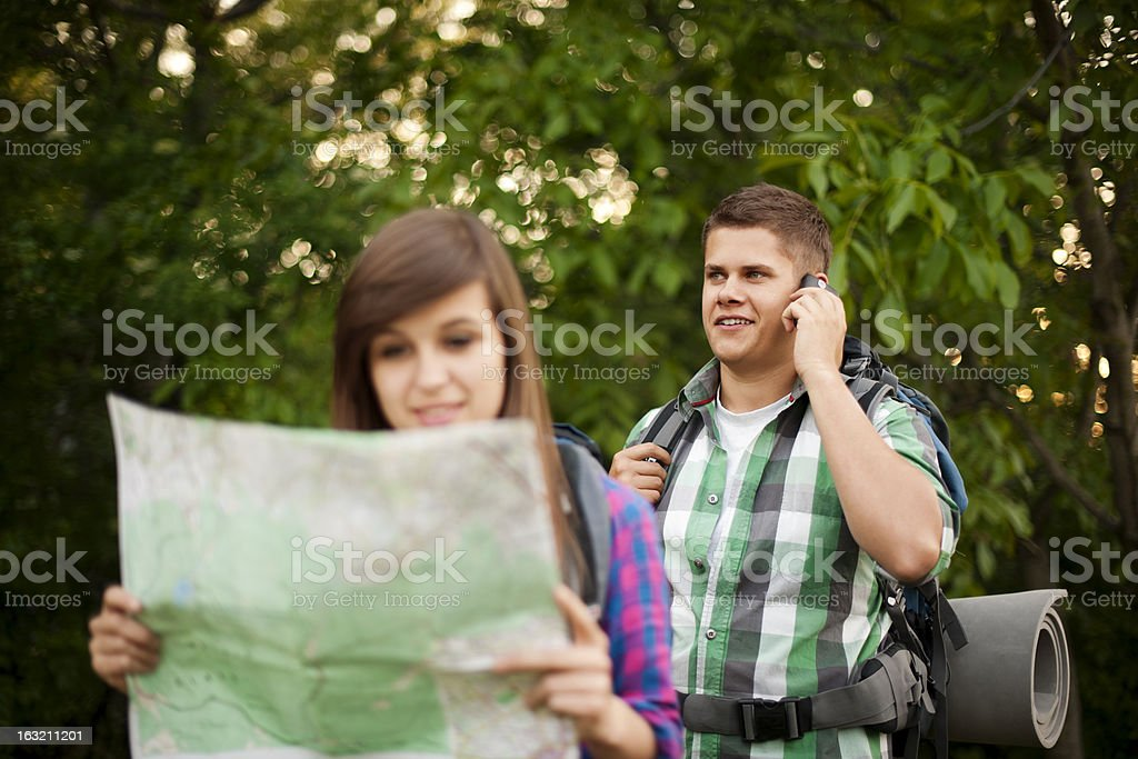 Young couple in forest royalty-free stock photo