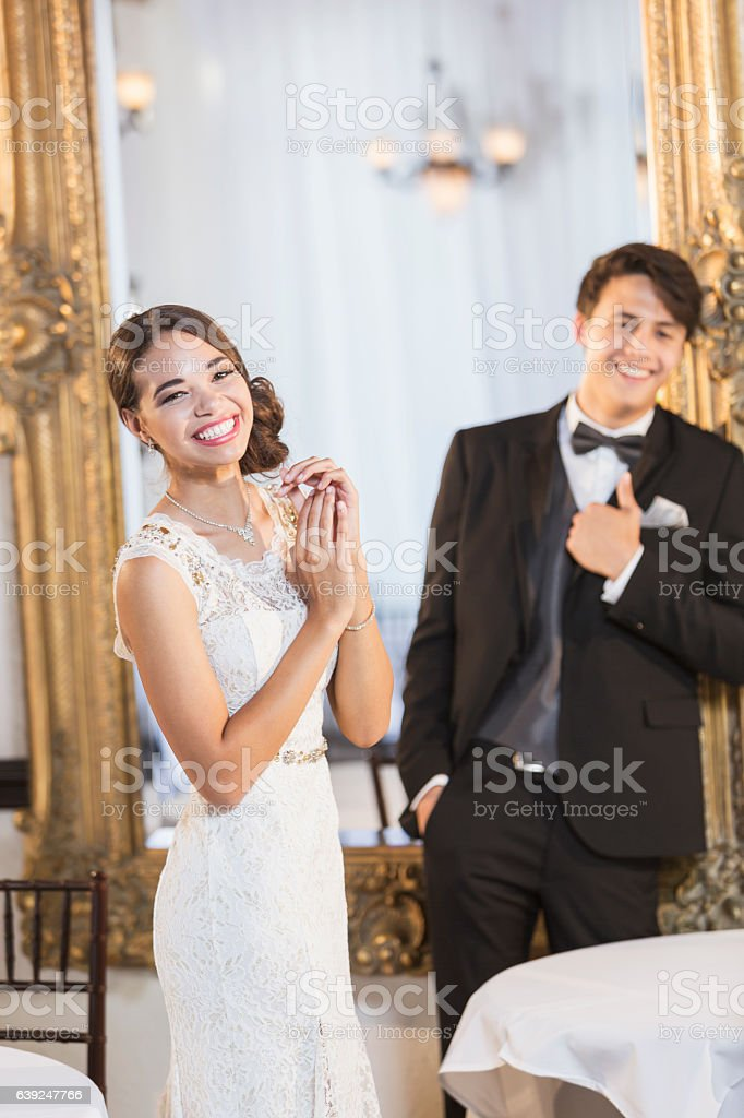 Young couple in formal attire stock photo