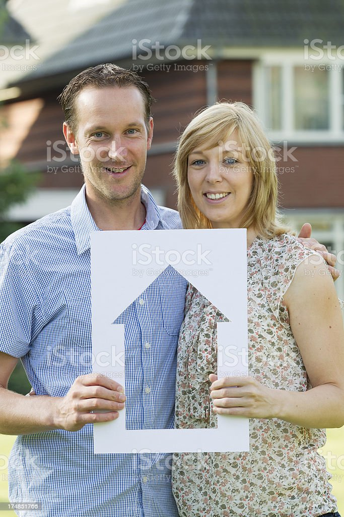 Young couple in front of house. royalty-free stock photo