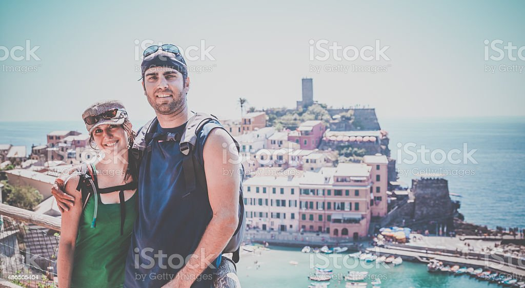 Young Couple In Front of Vernazza, Cinque Terre, Italy stock photo