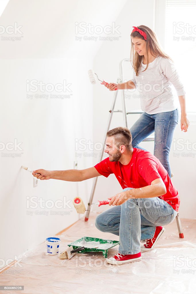 Young couple in home improvement works stock photo