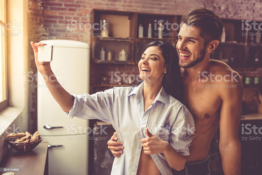 Young couple in kitchen stock photo