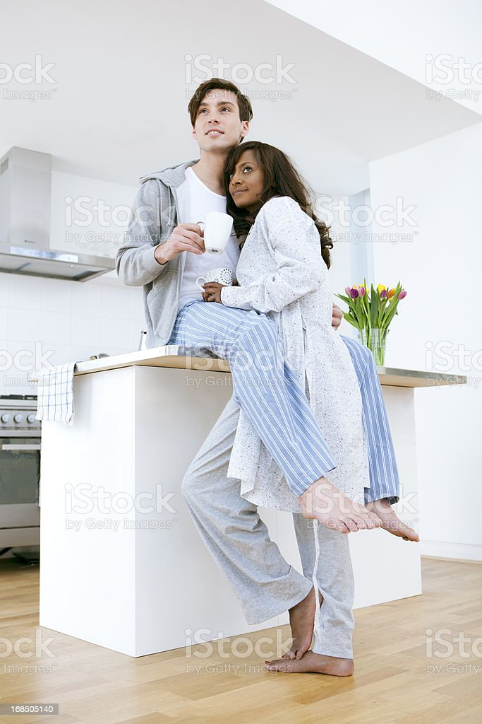 Young Couple in Kitchen Wearing Pajamas royalty-free stock photo