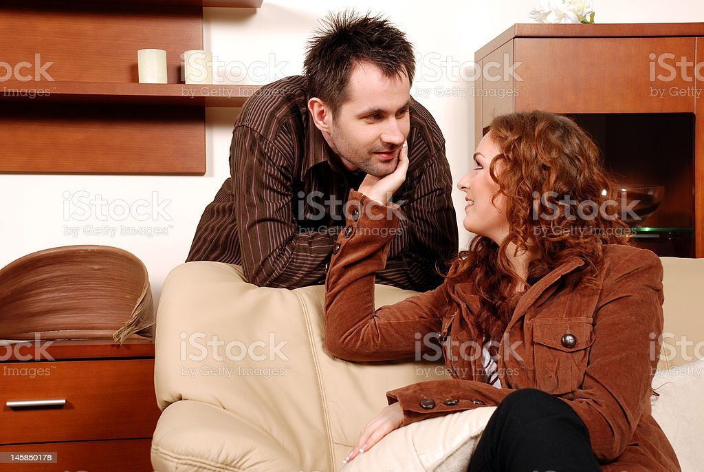 Young couple in living room. royalty-free stock photo