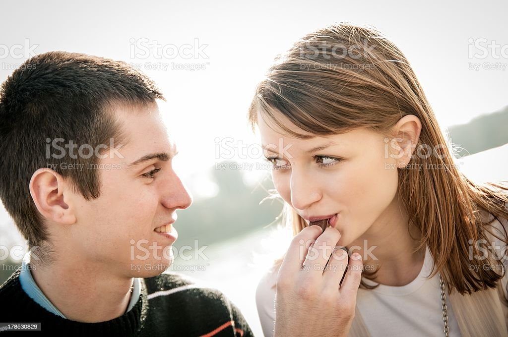 Young couple in locve eating chocolate royalty-free stock photo
