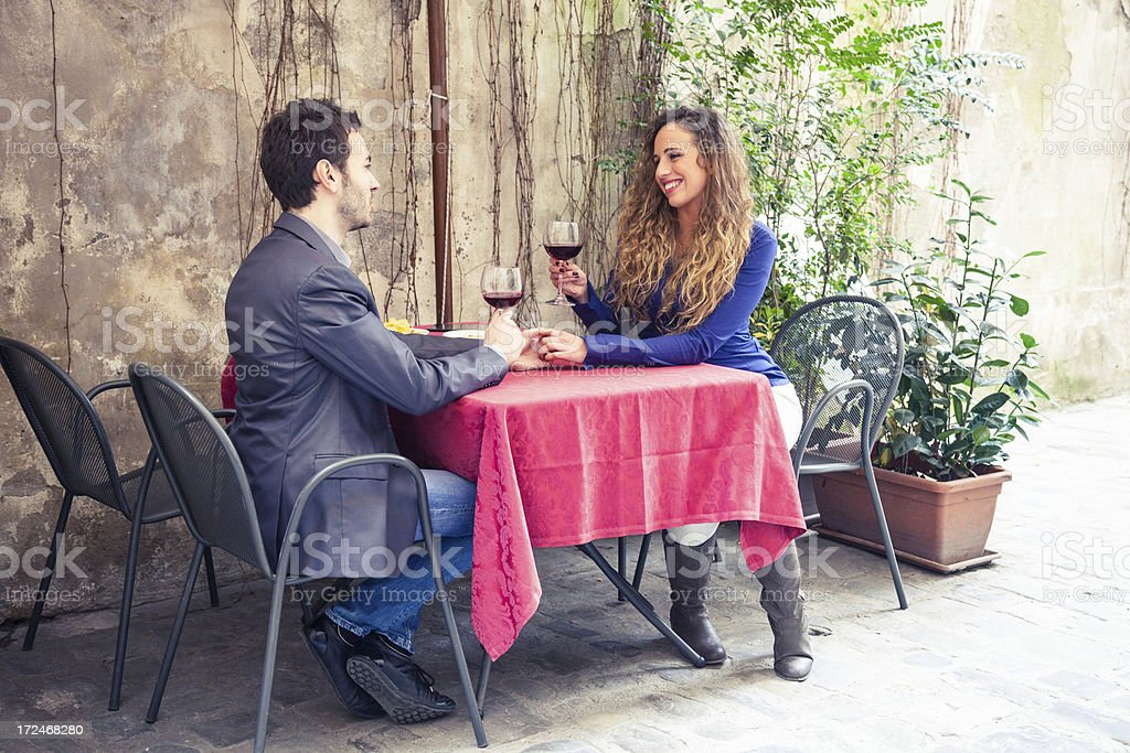 Young couple in love at restaurant royalty-free stock photo