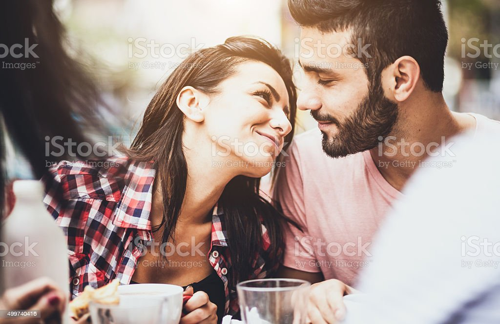 Young couple in love at the coffee bar stock photo