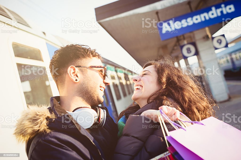 Young couple in love at train station stock photo