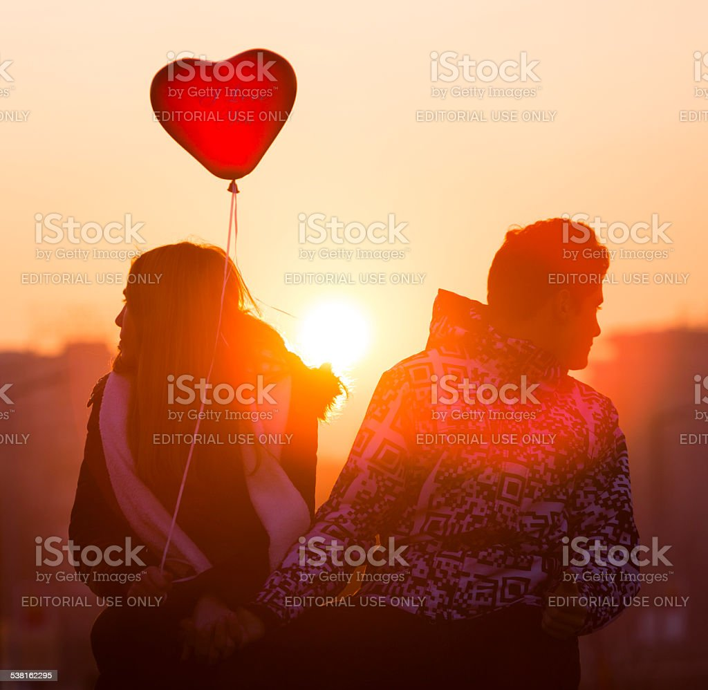 Young couple in love balloon heart stock photo