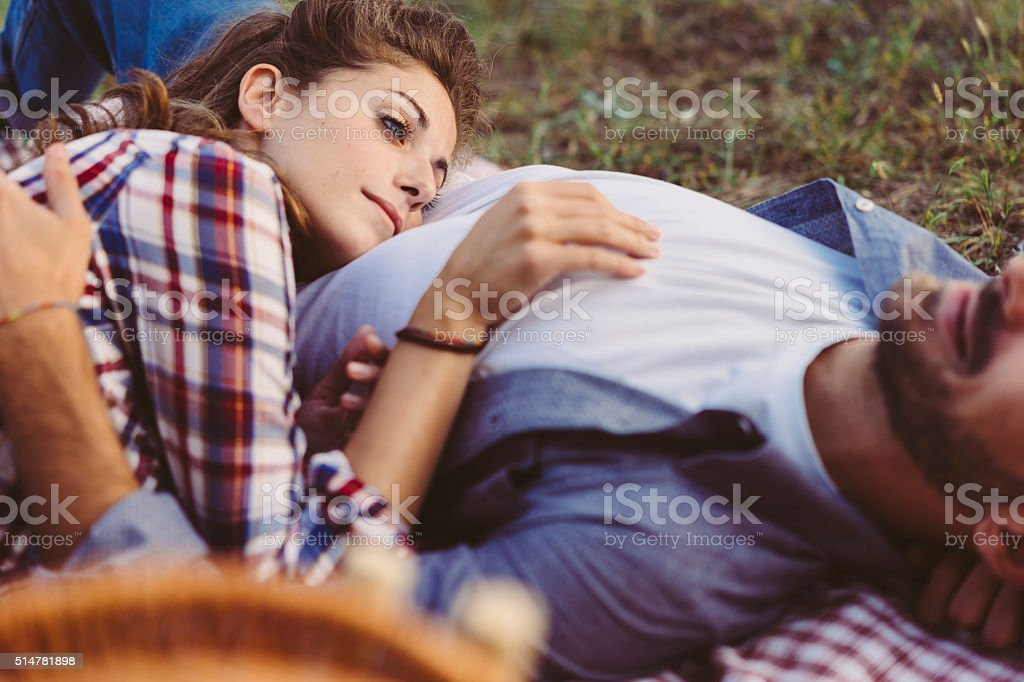 Young couple in love doing a picnic outdoors stock photo