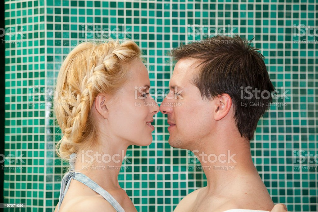 young couple in love embrace in health spa stock photo
