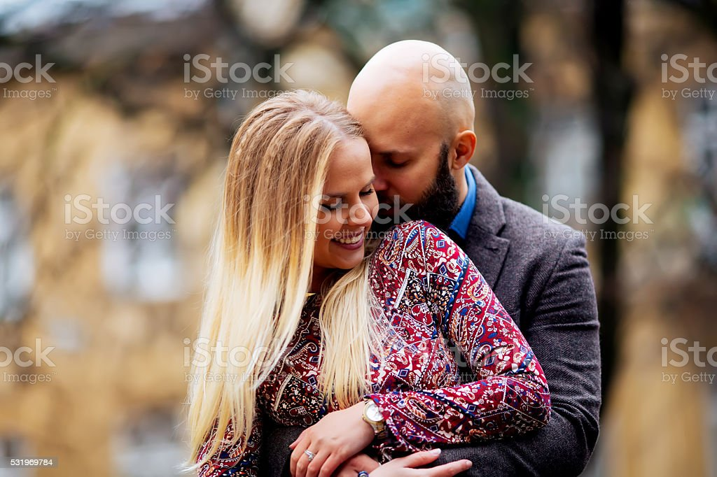 Young couple in love, hugging on the street. Selective focus. royalty-free stock photo
