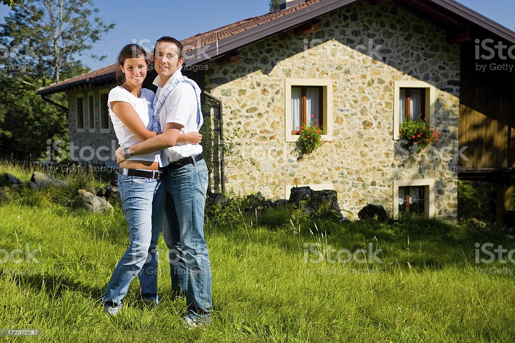 young couple in love hugs near their home royalty-free stock photo