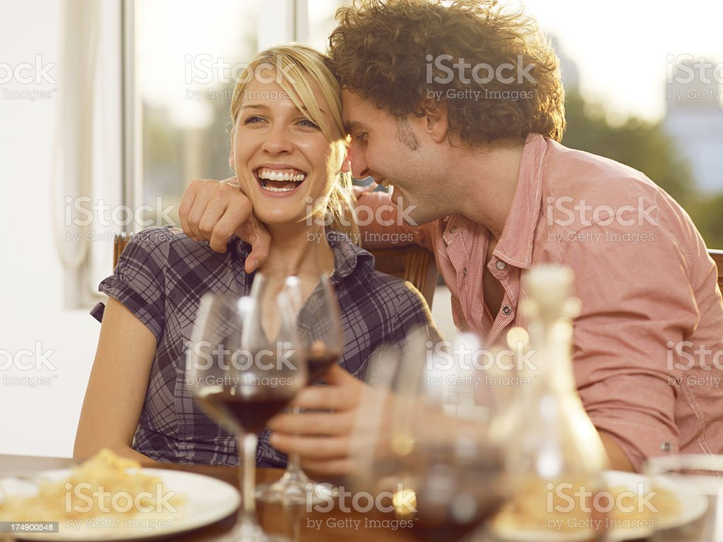 Young couple in love is enjoying wine and spagetti stock photo