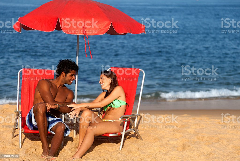 Young couple in love on the beach royalty-free stock photo