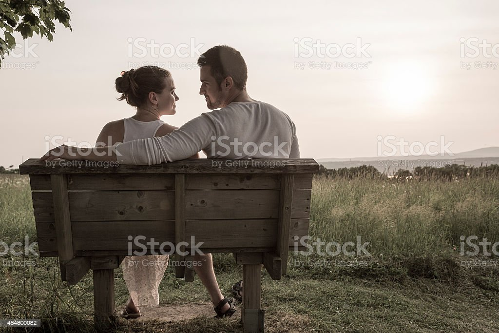Young couple in love outdoor at the sunset stock photo