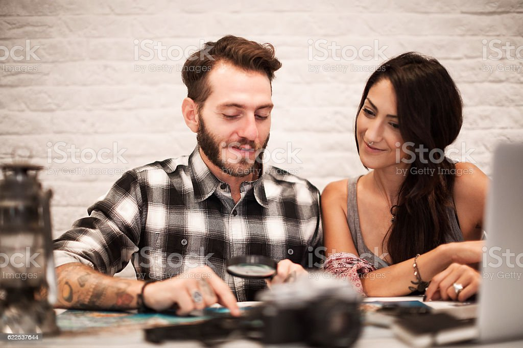 Young couple in love planning a trip stock photo