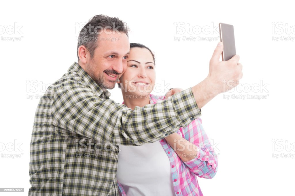 Young couple in love taking selfie stock photo