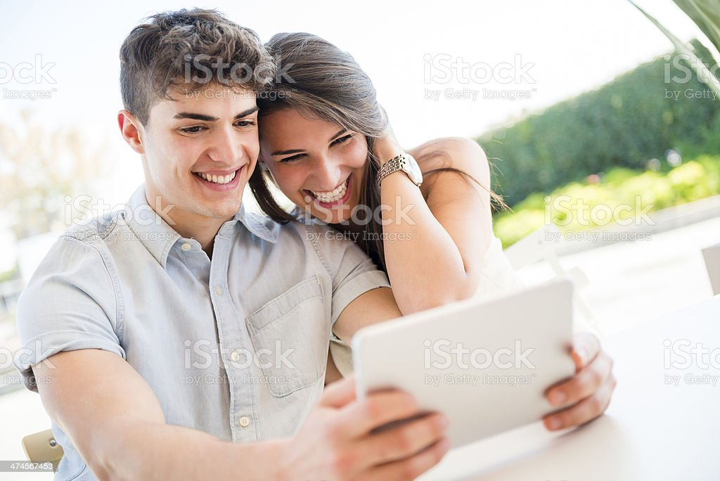 Young couple in love using digital tablet royalty-free stock photo