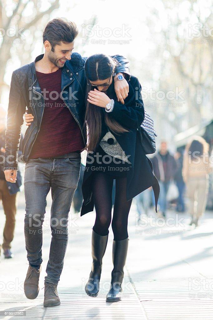 Young couple in love walking in Barcelona's Ramblas. stock photo