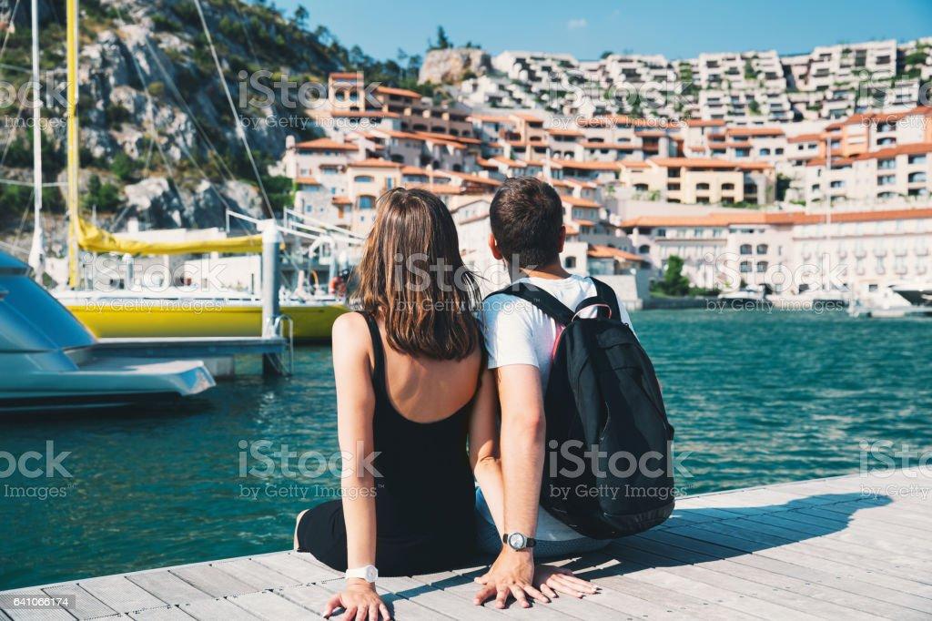 Young couple in love walking in Portopiccolo Sistiana, Italy, Europe. stock photo