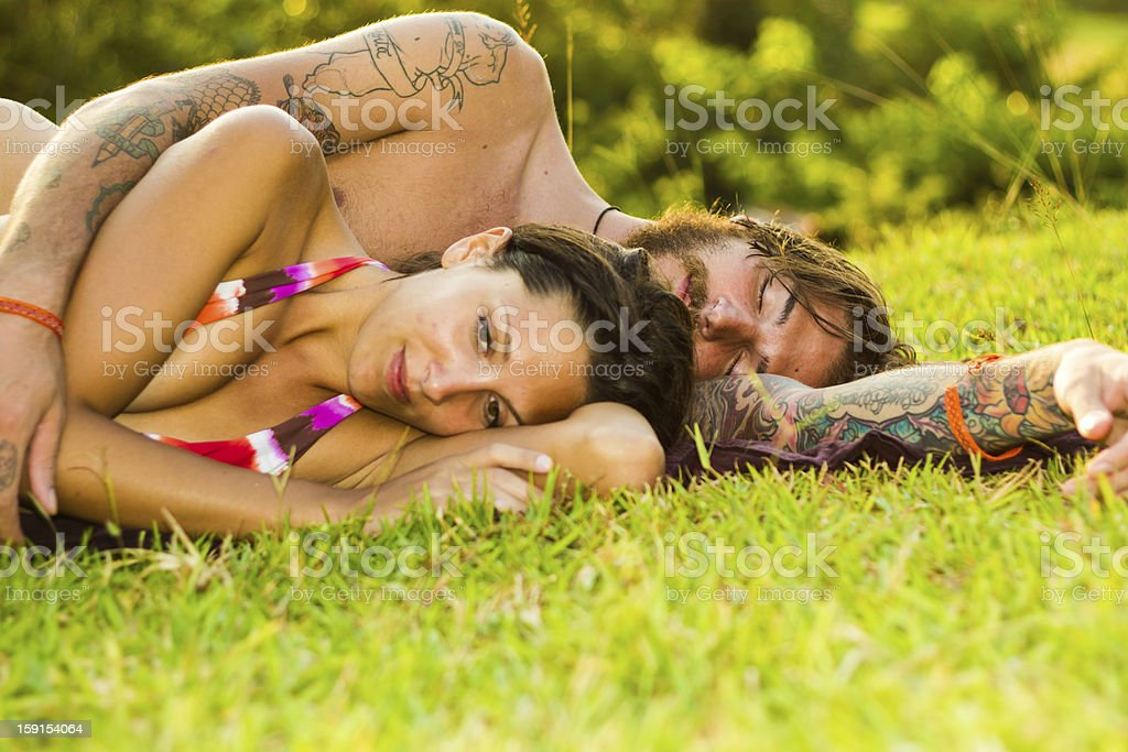 young couple in meadow stock photo
