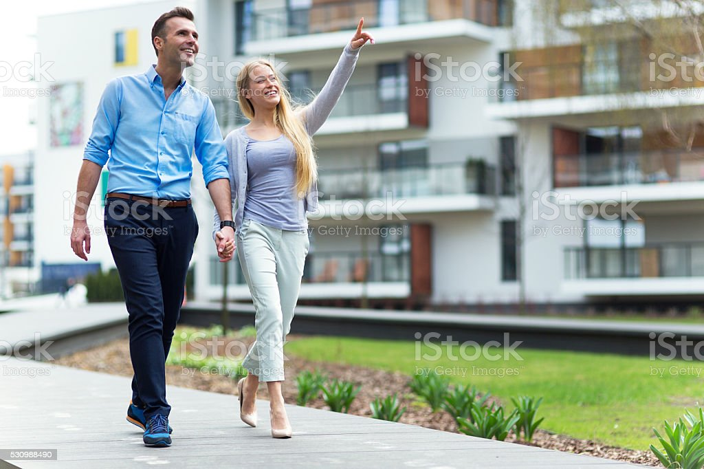 Young couple in modern residential area stock photo