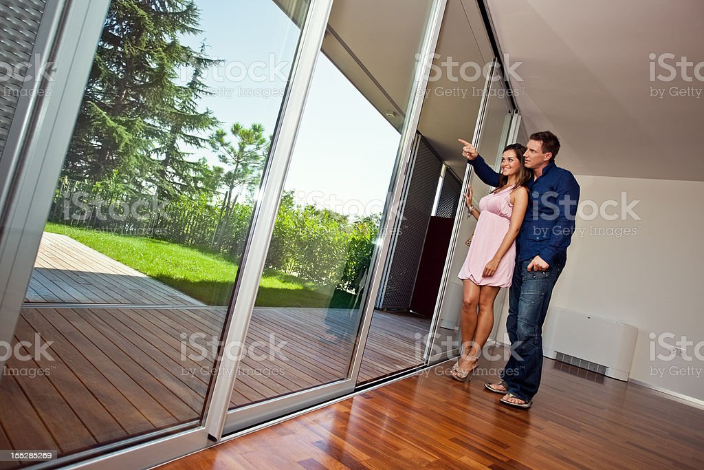 Young couple in new flat stock photo