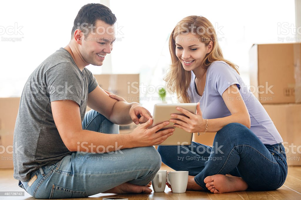 Young couple in new home making decisions stock photo