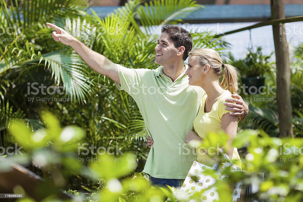 young couple in nursery royalty-free stock photo