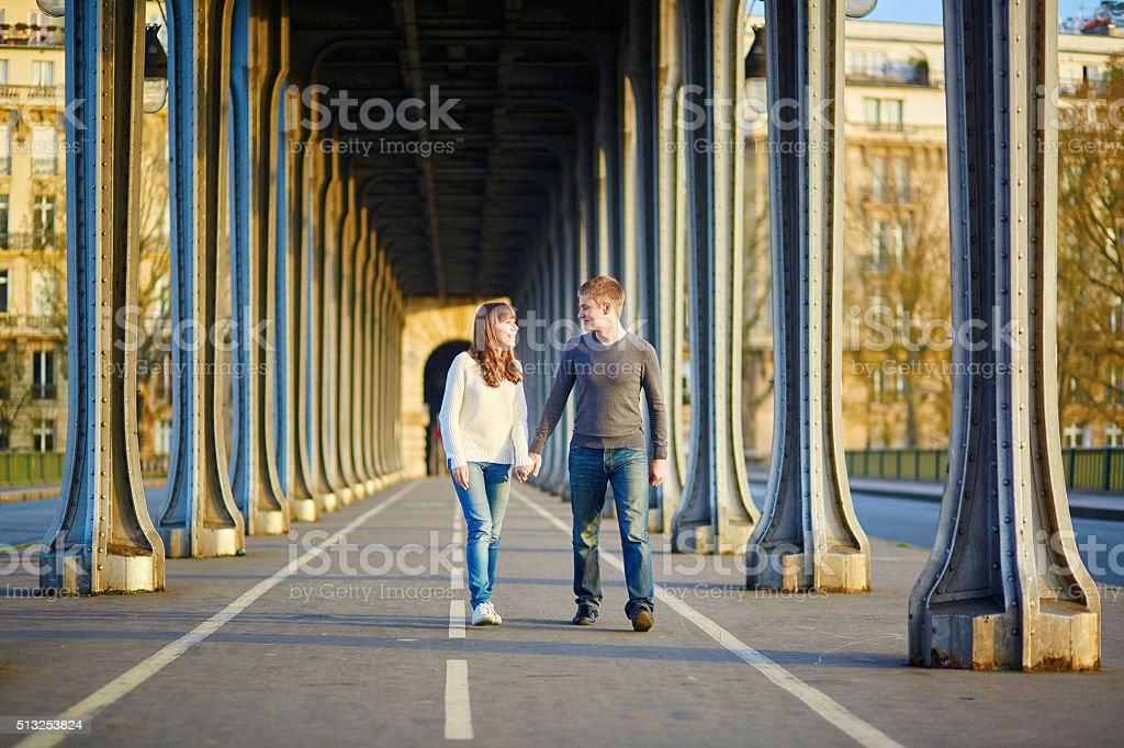 Young couple in Paris on the Bir Hakeim bridge stock photo