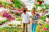 Young couple in plant and flower nursery